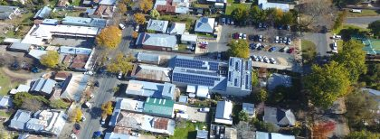 An aerial shot of Yackandandah showing the supermarket roof with solar panels