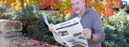 A person reading a newspaper