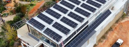 solar panels on an old sawmill roof